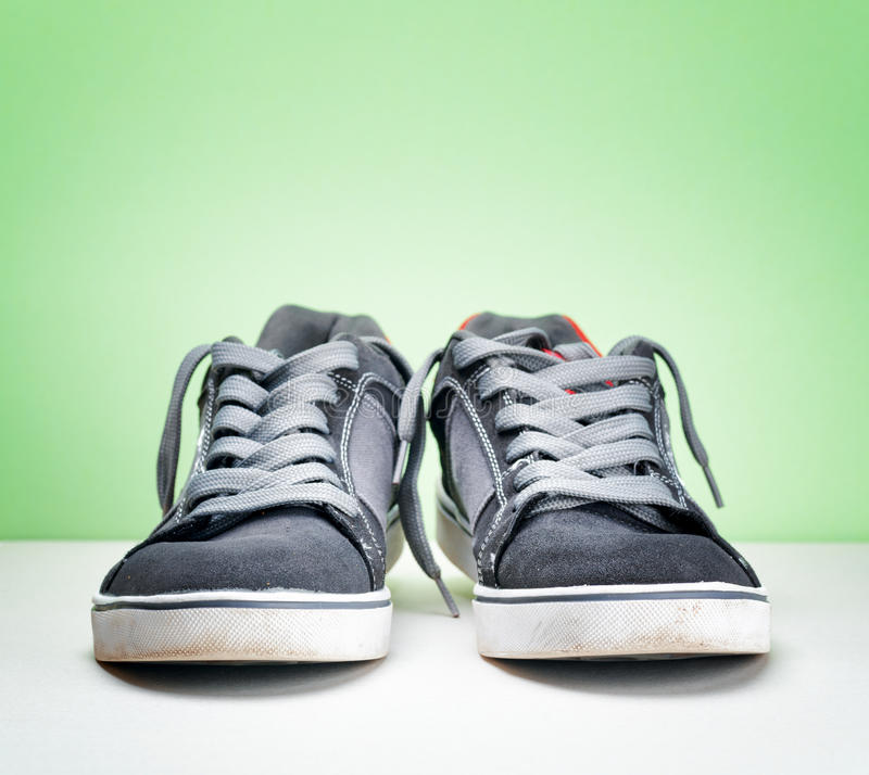 Download Pair Of Grey Sneakers On Colorful Background Stock Photo - Image of background, jogging: 42182434