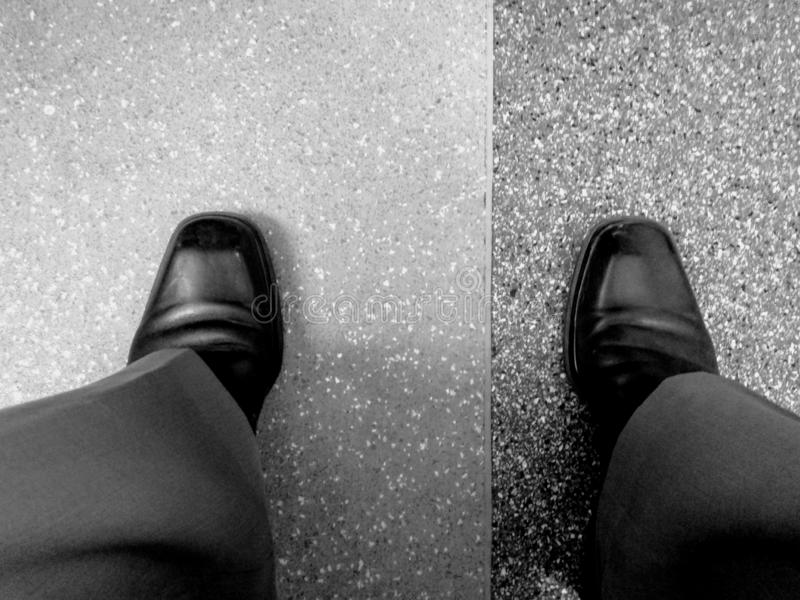 Shoes Position In Philosophy. Black, white royalty free stock photography