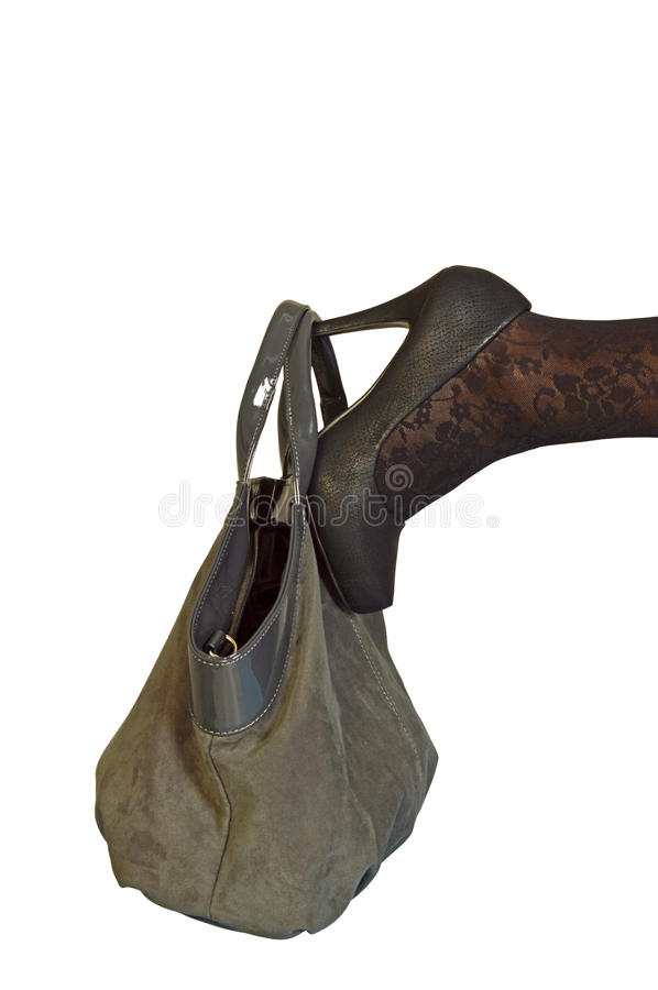 Shoes and purse of a woman in autumn clothing stock photography