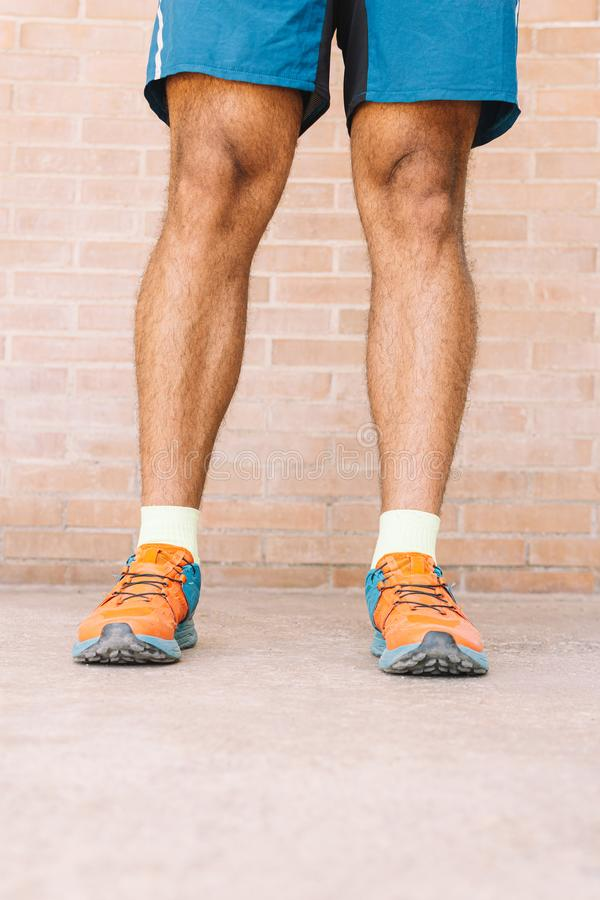 Shoes on running track field. Of the man stock photography