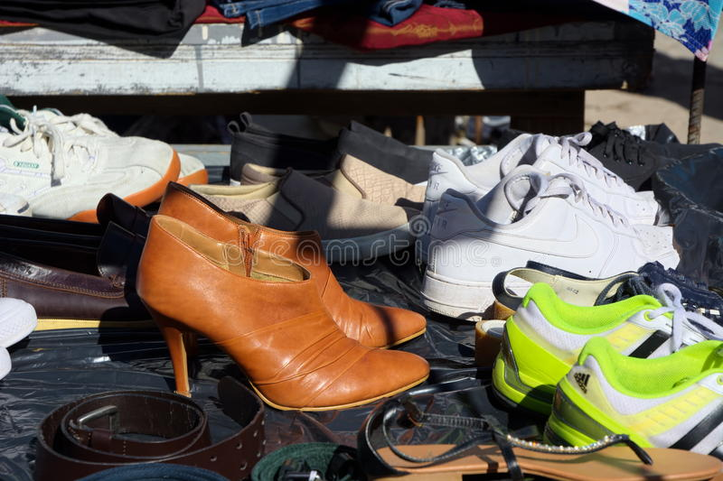 Shoes for sale at a car boot fair. royalty free stock image