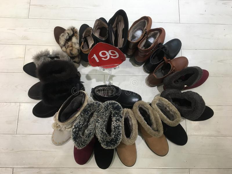 Shoes on sale. Various winter shoes in different styles in promotion for 199 Chinese Yuan royalty free stock photos