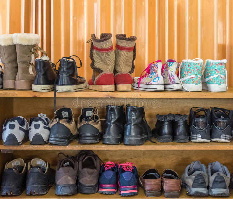 Shoes are on the shelf in indoor. Various style of shoes in one place royalty free stock photo