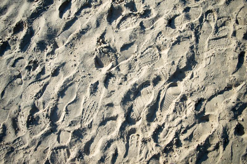 Shoes track on sand, background texture. Construction Materials royalty free stock photos