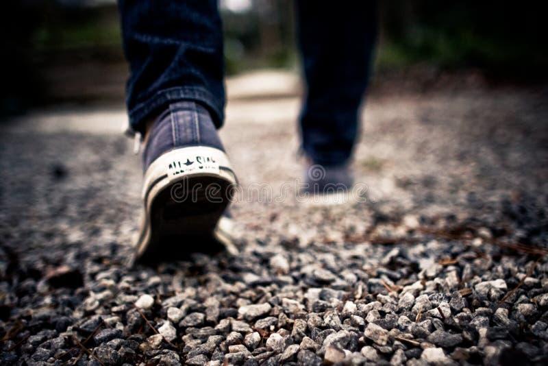 Shoes Walking Feet Grey Gravel Blue Jeans royalty free stock photo