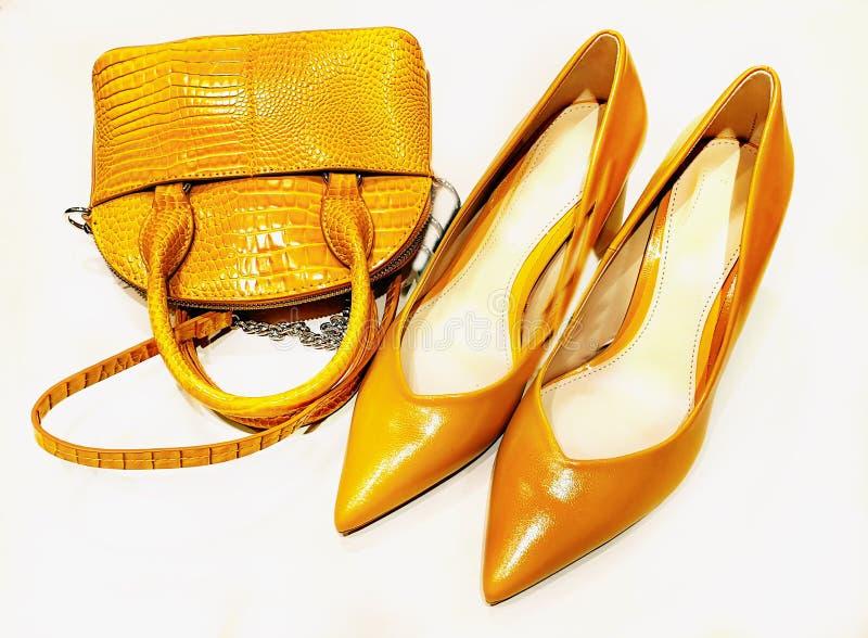 Handbag shoes on high heels yellow trends summer Autumn fashion women clothes. Shoes yellow natural leather women shoes on high heel,summer Autumn season women royalty free stock photos