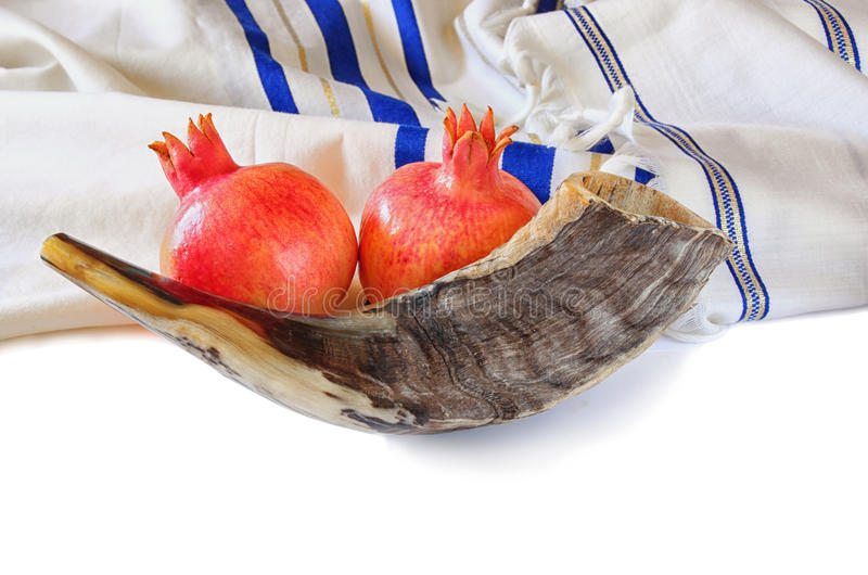 Shofar (horn), white prayer talit and pomegranate isolated on white. rosh hashanah (jewish holiday) concept . traditional holiday. Symbol stock image
