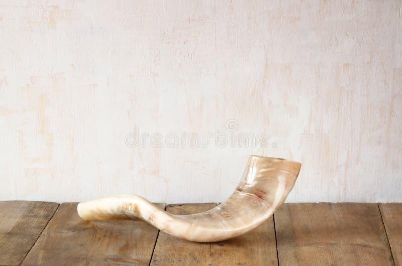 Shofar (horn) on wooden table. rosh hashanah (jewish holiday) concept . traditional holiday symbol. stock photos