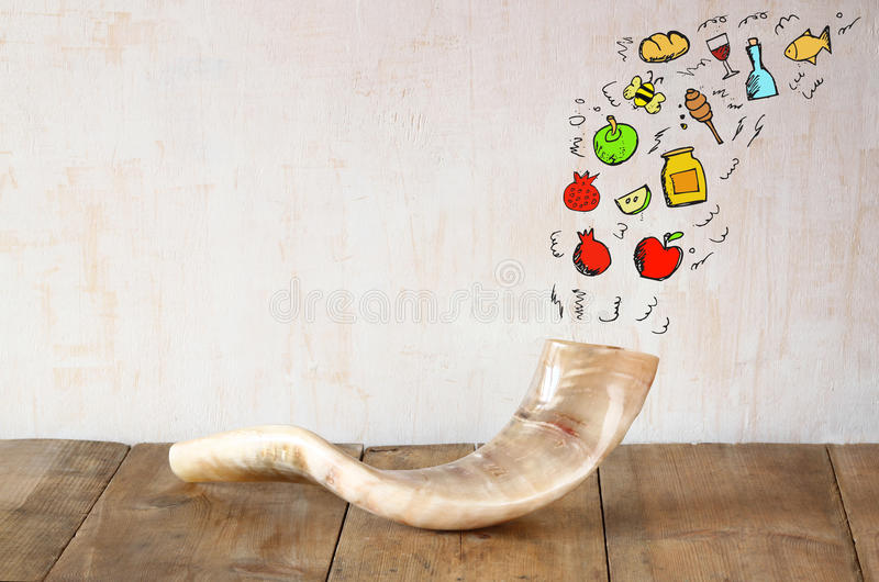 Shofar (horn) on wooden table with set of infographics over textured background. rosh hashanah (jewish holiday) concept . stock images