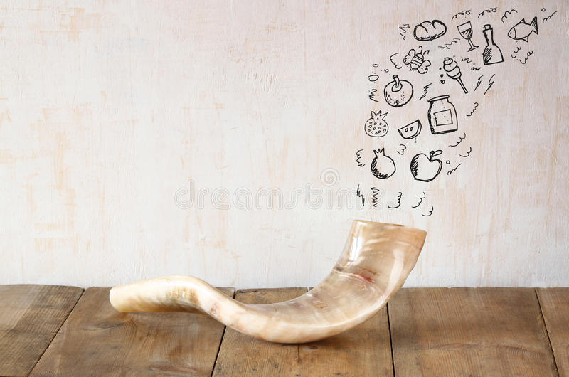 Shofar (horn) on wooden table with set of infographics over textured background. rosh hashanah (jewish holiday) concept . royalty free stock image