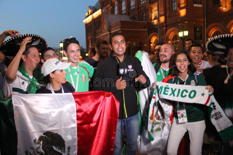 Shoot news for Mexican television, are live broadcast on TV with fans at the world Cup in Moscow stock photography