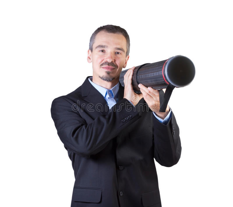 Shoot the target with your presentation. Man shooting document tube like a bazooka isolated on white background royalty free stock photography