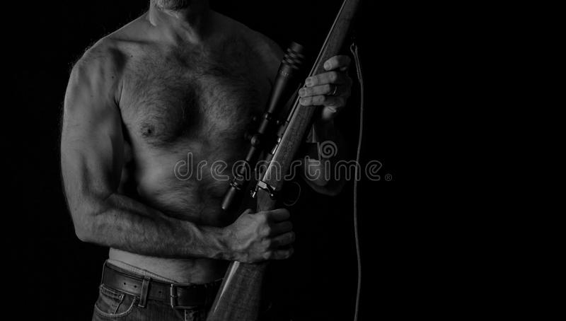 Shooter with Rifle stock photo