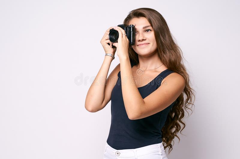 Shooting. Black camera. Young photographer stock images