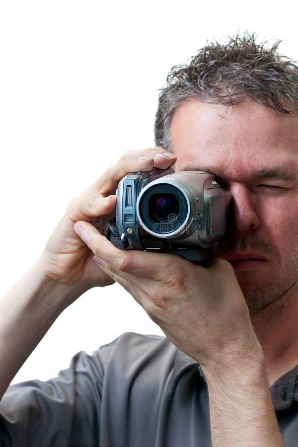Shooting del hombre con una cámara de vídeo imagenes de archivo