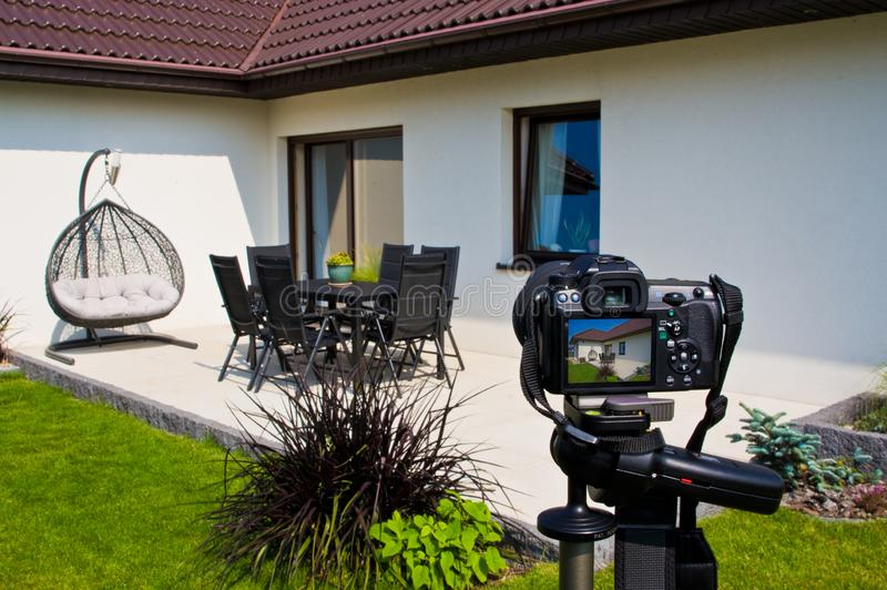 Shooting house exterior, photographer camera, tripod and ballhead royalty free stock images
