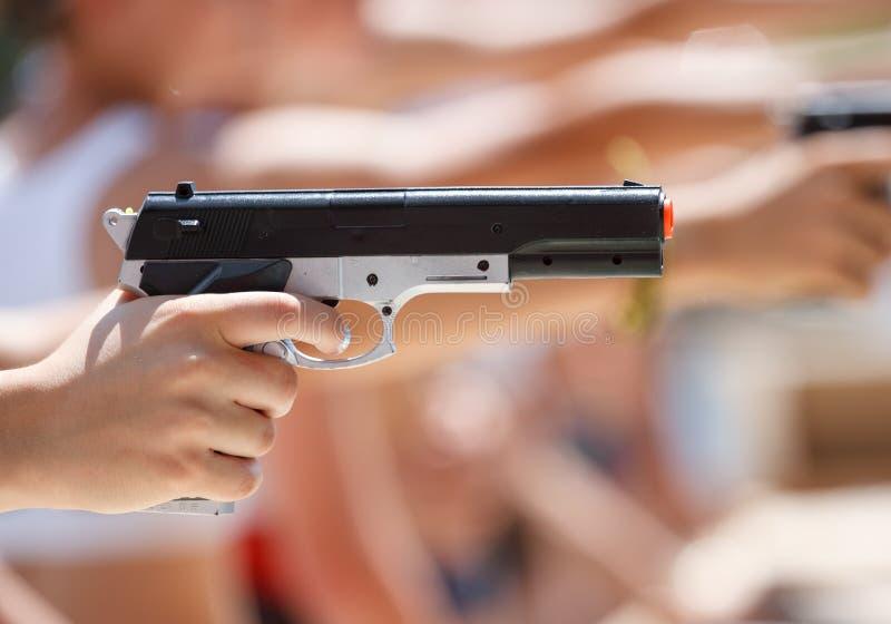 Shooting pneumatic pistol royalty free stock photo
