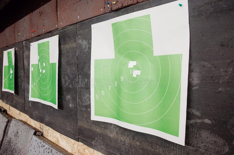 Shooting range gun. Paper target in white and green color for hit royalty free stock image