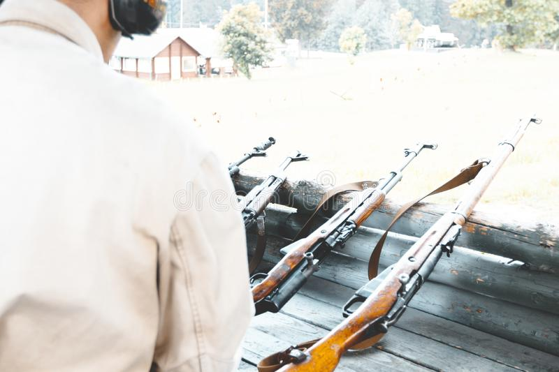 at the shooting range. military reload automatic machine for shooting. there is toning royalty free stock image