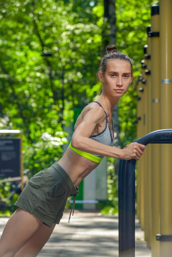 shooting sportswoman with a muscular figure stock photography