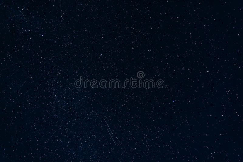 Shooting stars against starry blue of night sky with milky way. Shooting stars against the starry blue of the night sky with the milky way stock photography