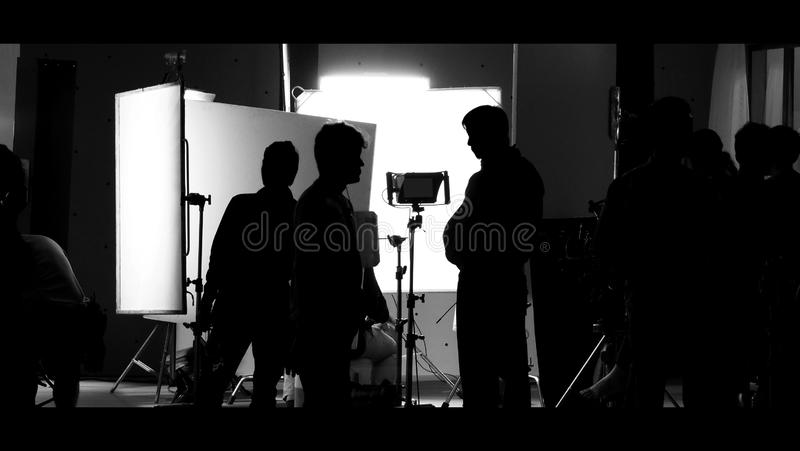 Shooting studio behind the scenes in silhouette images stock image