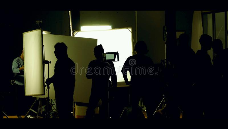 Shooting studio behind the scenes in silhouette images stock photo