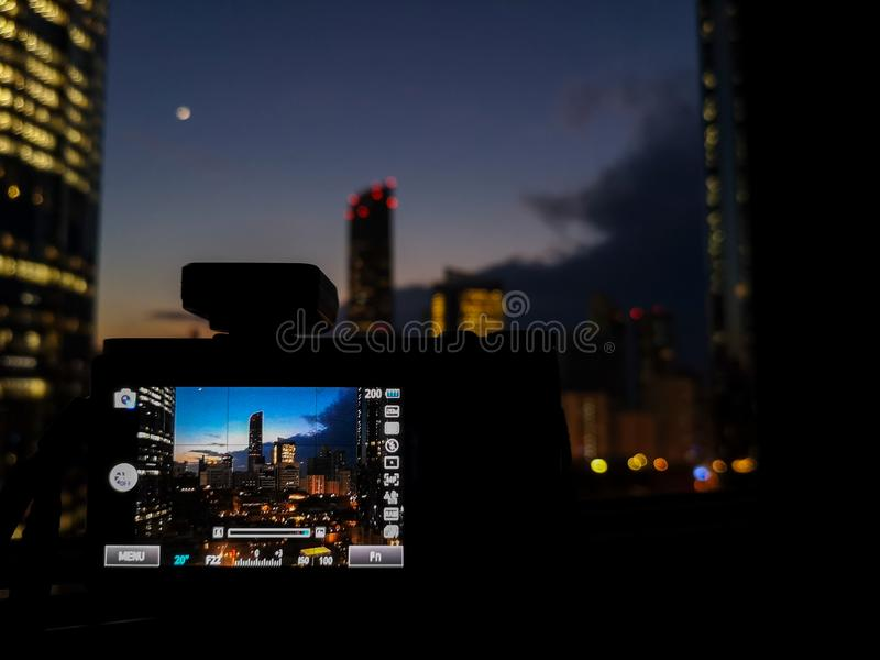 Shooting a time lapse/image of modern skyscrapers in the city at night.  royalty free stock image