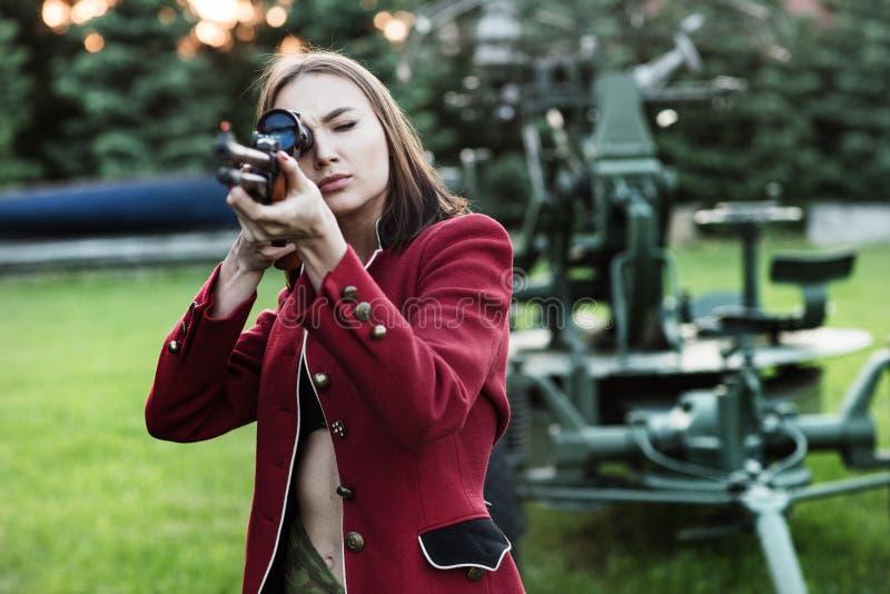 Shooting women holding a gun. Shooting woman holding a gun stock photo