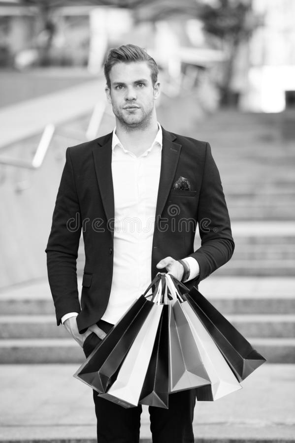 Shop alone. People find shopping partners more akin accomplices in crime. Man carry shopping bag. Guy shopped alone. Bought exactly what he needs. Alone royalty free stock images
