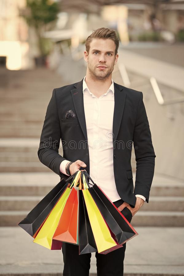 Shop alone. People find shopping partners more akin accomplices in crime. Man carry shopping bag. Guy shopped alone. Bought exactly what he needs. Alone stock image