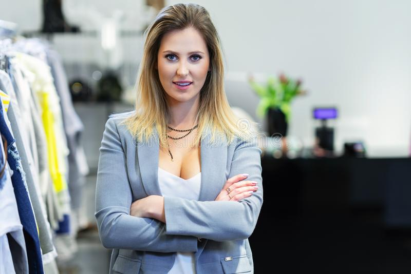 Sales assistant in clothing store stock photos