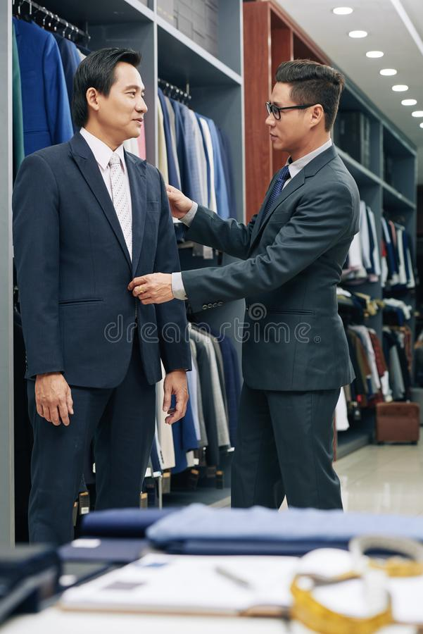 Shop assistant helping client royalty free stock photos