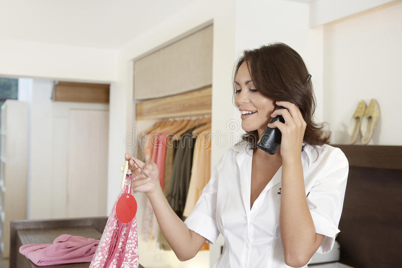Download Shop Attendant On Phone Stock Photo - Image: 25672280