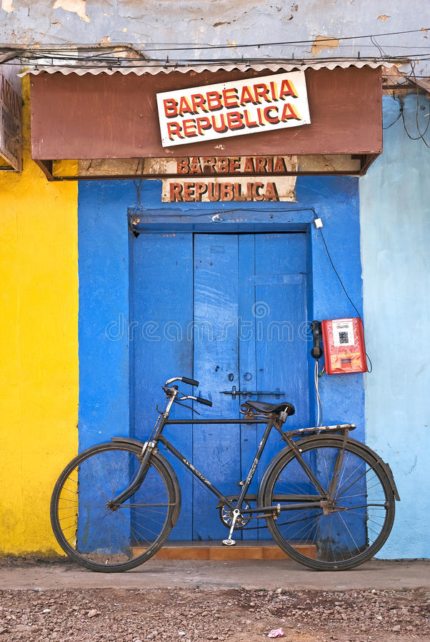 Shop on street in goa india. Shop and bicycle on street in panjim goa india stock photo