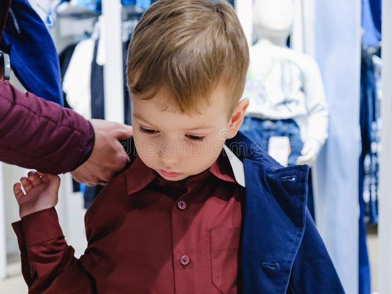 Shop boy child kid fitting. retail baby. Shop boy child kid fitting buy sale. retail baby stock image