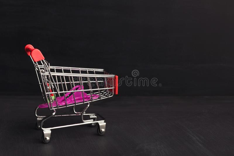 Shop cart on black background royalty free stock photo