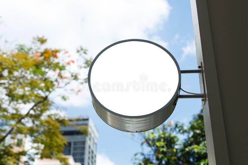 Shop circular lightbox. Empty shop circular shape lightbox mounted on wall for logo or advertising royalty free stock photos