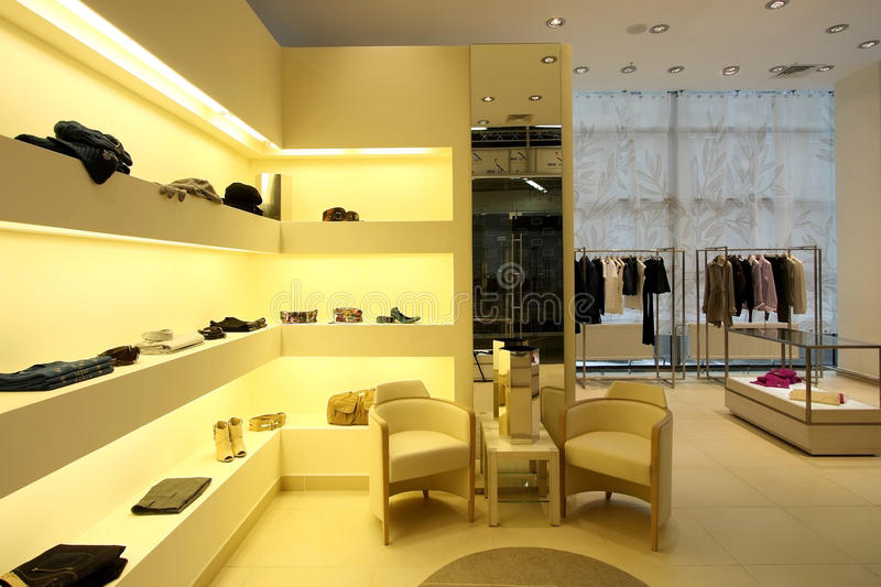 Shop of clothes. Interior of modern shop of clothes royalty free stock images