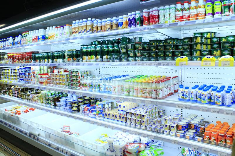 Shop of dairy products. Chernihiv / Ukraine. 26 August 2017: wide choice of different yogurts and others dairy produce on the shelves of shop. 26 August 2017 in royalty free stock image