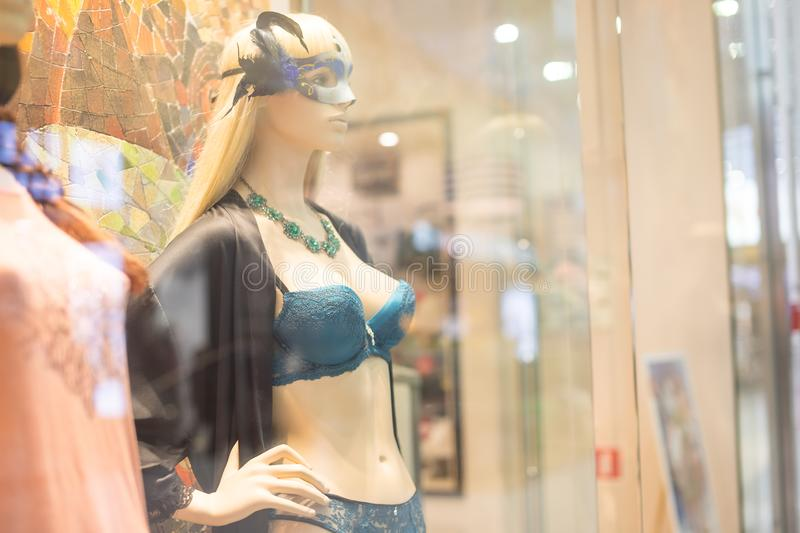 Shop dummy underwear fashion lingerie mannequin in department store boutique window wearing current fashions in clothes royalty free stock image