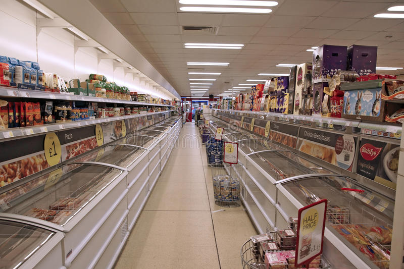 Shop Freezers. A double row of freezers in Iceland shop selling frozen meat,vegetables, icecream and various food stuffs above royalty free stock photo