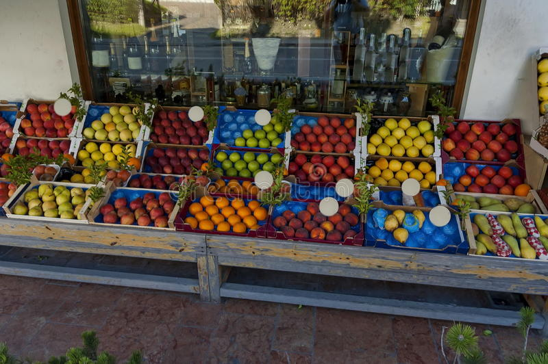 Shop with fresh fruit on the street, jam and alcoholic drinks inside, Cortina D`Ampezzo, Dolomites, Alps, Veneto royalty free stock photography