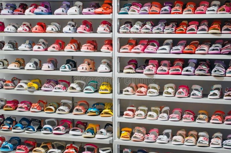 Shop kid shoes, shelves. Russia, Saint-Petersburg. June 2017. royalty free stock images
