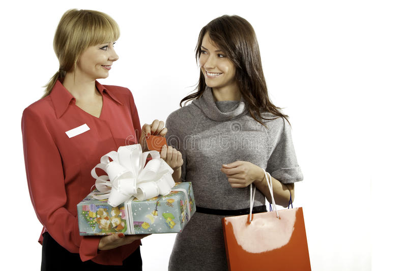 Shop manager and customer stock photography