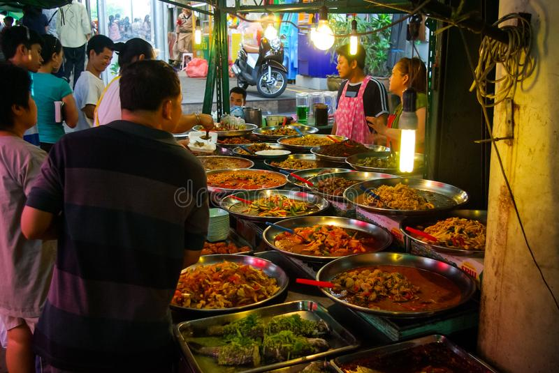 Shop on the market in Bangkok, people sell fruit and seafood stock photo