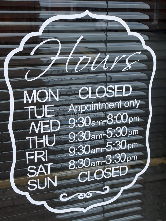 Shop opening hours stock image