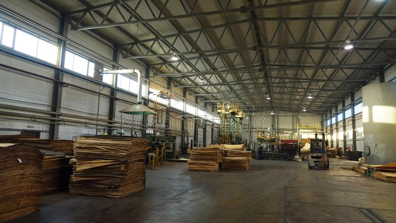 Shop for the production of plywood. Processing of business wood. Woodworking industry. Shop for the production of plywood. Processing of business wood royalty free stock images