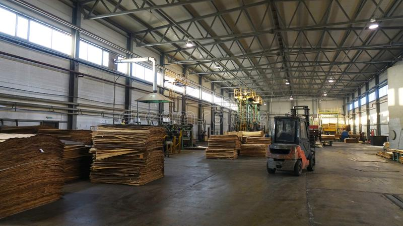 Shop for the production of plywood. Processing of business wood. Woodworking industry. Shop for the production of plywood. Processing of business wood royalty free stock image