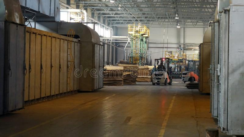 Shop for the production of plywood. Processing of business wood. Woodworking industry. Shop for the production of plywood. Processing of business wood royalty free stock photography